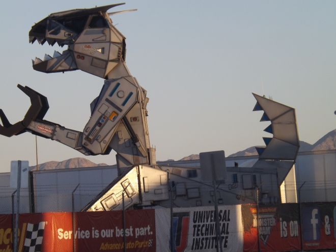 "A Mechanical T-Rex ""rests"" in between shows at the Monster Jam atSam Boyd Silver Bowl Friday - Photo by Royal"