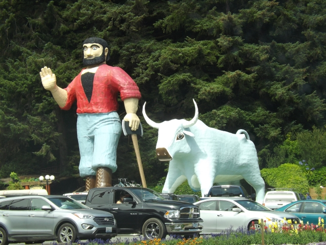 Giant statues of American mythological figures Paul Bunyan and Babe the Blue Ox stand near a cafe frequented by visitors to northern California tourists stops _ Photo by Royal Hopper