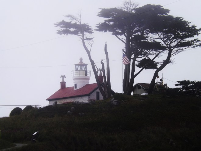 A beach lighthouse in the fog at a Northern California beach _ Photo by Royal Hopper