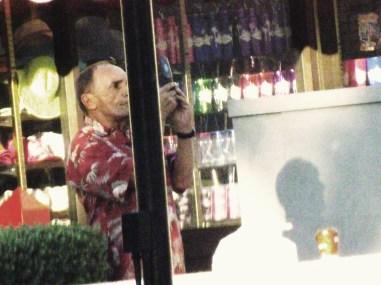 old guy in haiwaiin shirt taking a pic