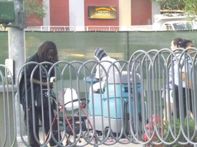people behind fence