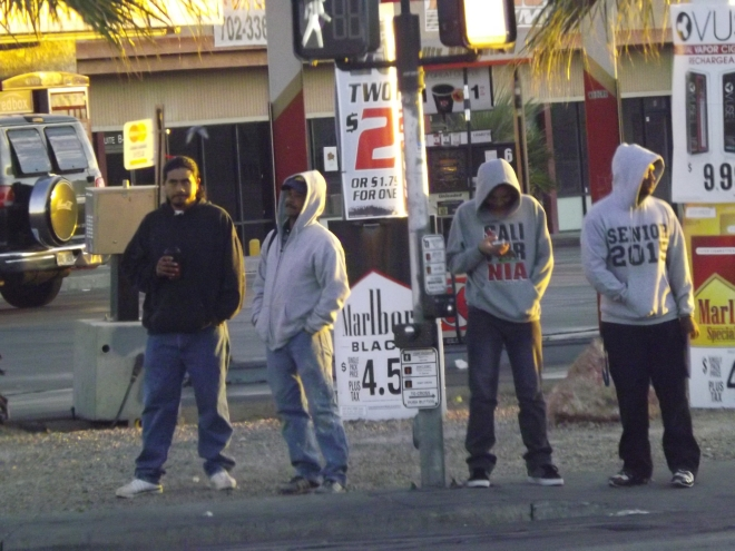 Hanging out on the Boulevard an unknown crew hangs out in the chilly desert weather _ Photo by Royal