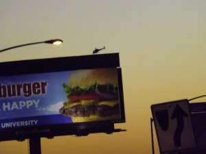 A billboard, a helicopter and a street light in the City if Sin _ Royal Hopper
