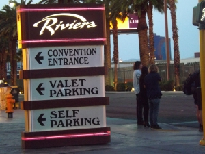 Signs are a part of the Sin City landscape. This one sits on the corner of Las Vegas Blvd directing gamblers to various useful things like parking - photo Royal Hopper