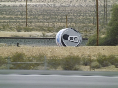 A 7 foot tall can of beer graces the side of a busy highway near the Utah Nevada border Thursday _ Photo Royal Hopper