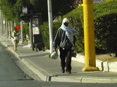 guy walking bundled