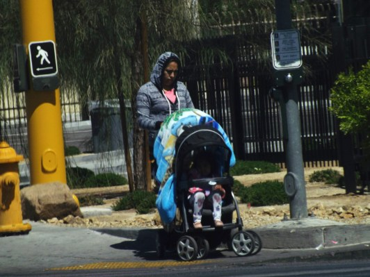 lady with stroller and hood