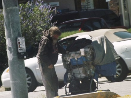 homeless guy with cart