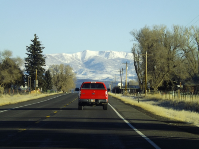 red pickup driving in moutains.JPG