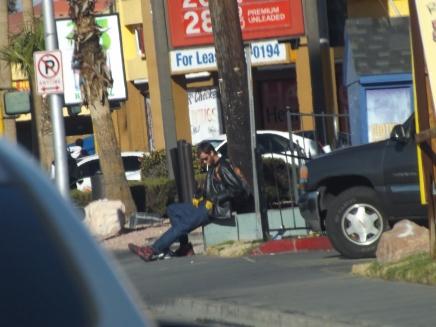 guy-chilling-on-sidewalk