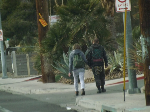 punk couple walking.JPG