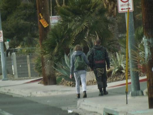 punk couple walking.JPG