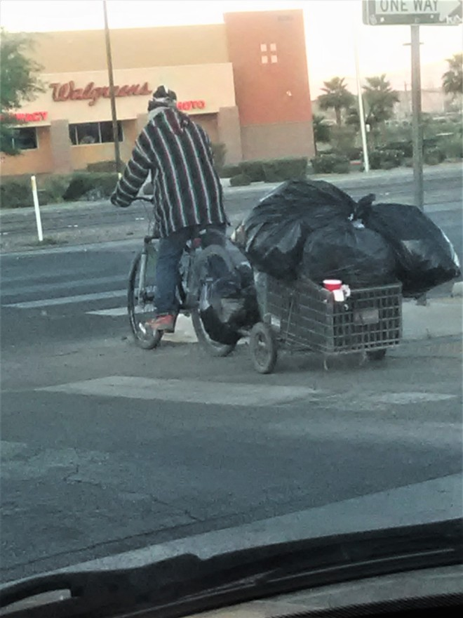 guy walking with cart